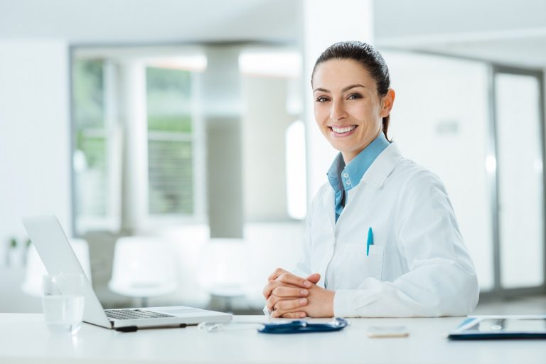 Female doctor working using her laptop