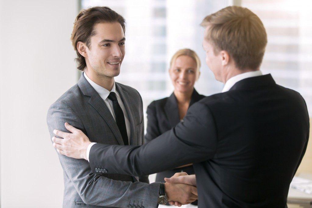 Senior manager motivating his associate