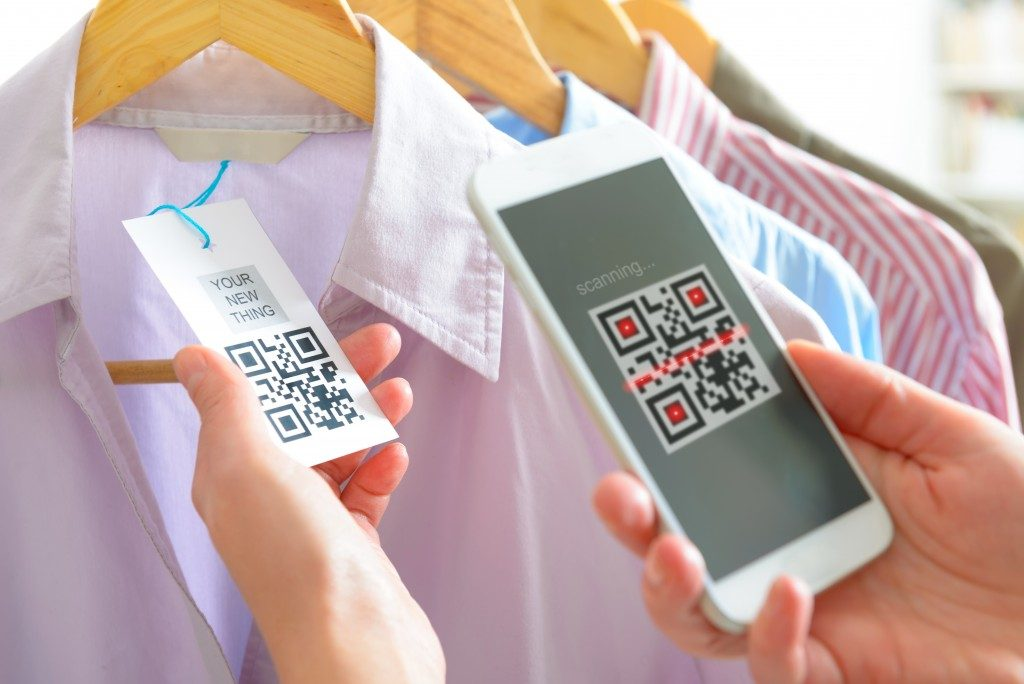 person using QR code scanner from phone