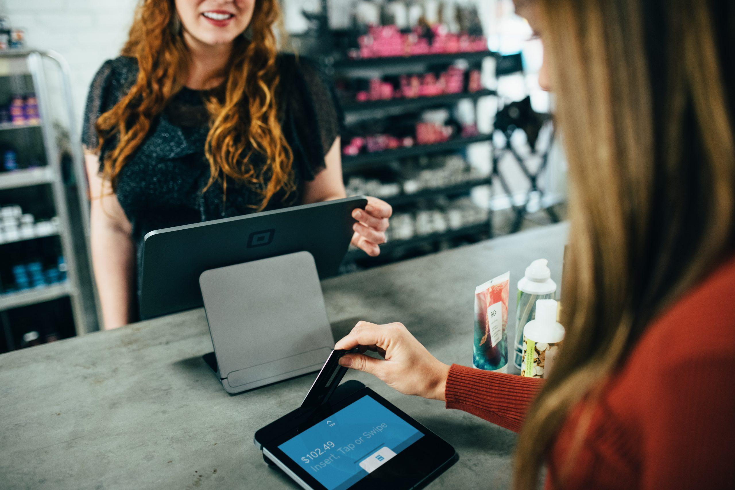 woman paying using credit card