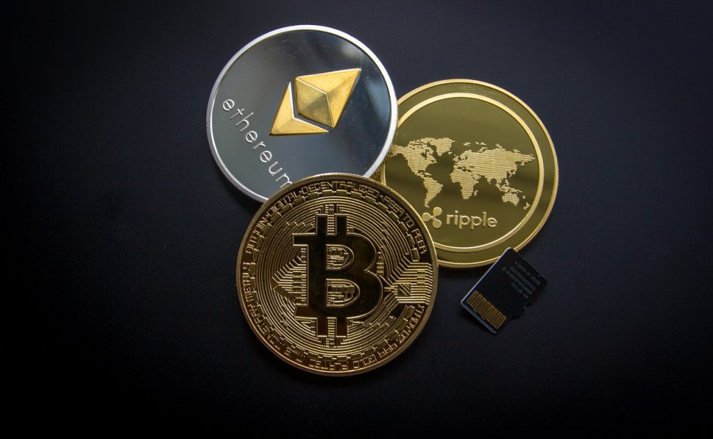 logos of cryptocurrency on coins