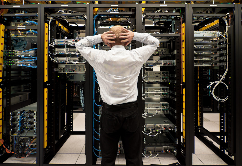 man in a network data center